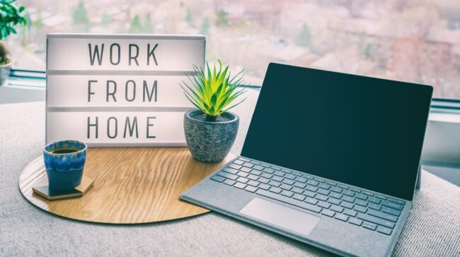 Working from home remote work inspirational social media lightbox message board next to laptop and coffee cup for COVID-19 quarantine closure of all businesses.
